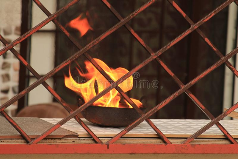 Flamme d'une action usuelle de hindus photo stock