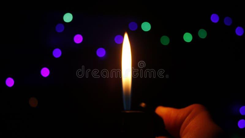 Flamme dans l'obscurité photographie stock libre de droits