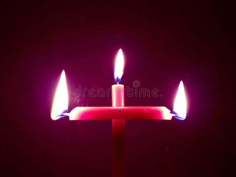 Flamme de bougies formée par Noël photo stock