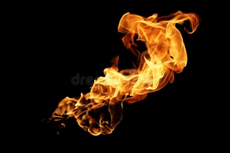Flammes du feu brouillées par résumé d'isolement sur le noir photographie stock libre de droits