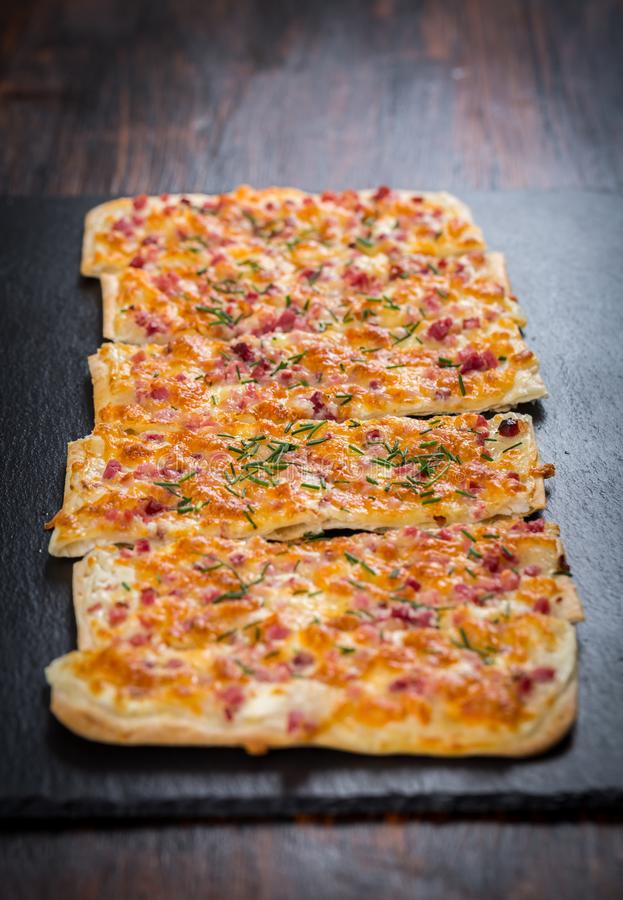Flammkuchen or Traditional Alsatian Pie royalty free stock image