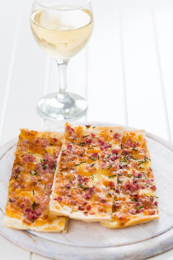 Flammkuchen or Traditional Alsatian Pie stock photos
