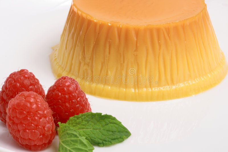 Flan dessert. Made with prime organic milk, berries and garnished with mint stock photos