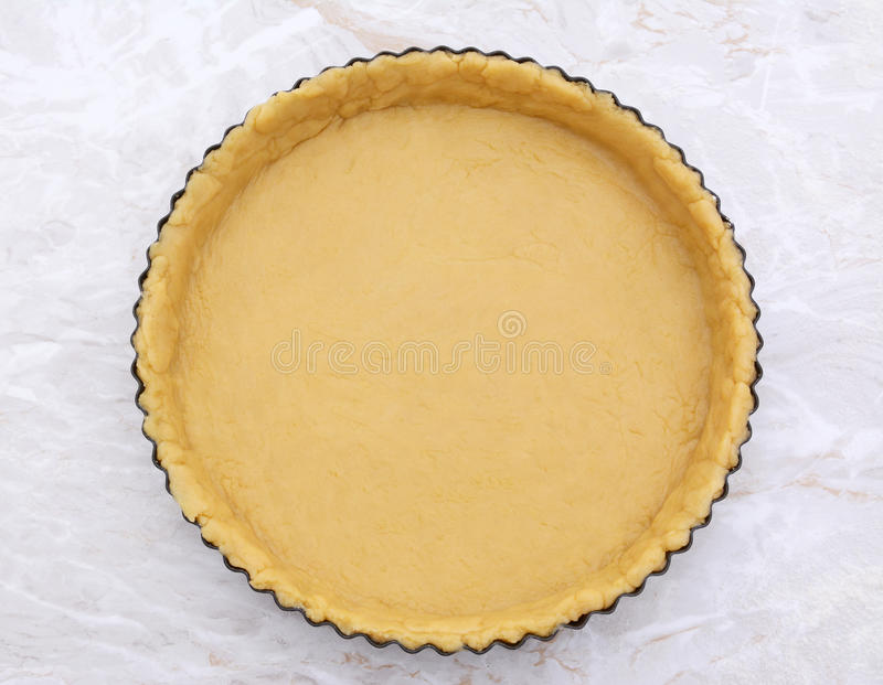 Flan tin lined with shortcrust pastry royalty free stock photo