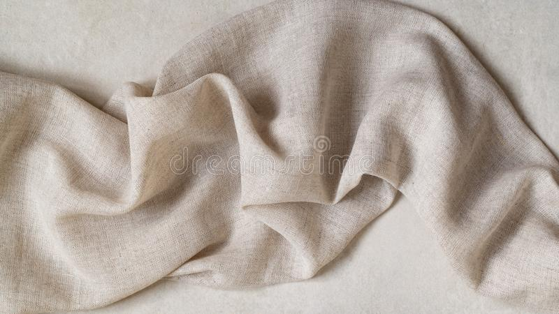 Flap of fine linen or hamp fabric on a gray background stock image