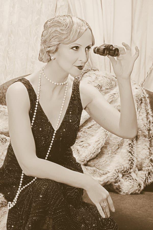 Flapper lady with binoculars stock photo