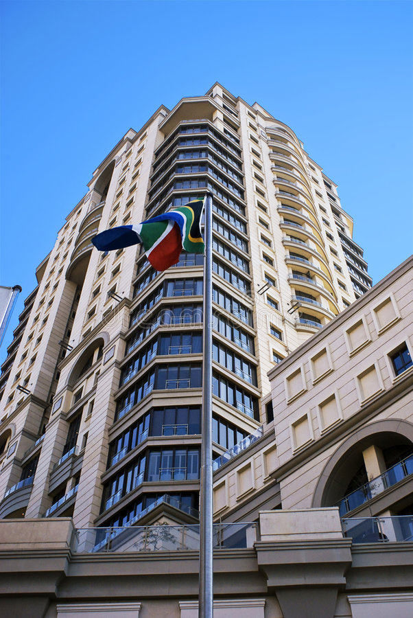 Flapping South African Flag. A sample of a South African flag. Captured in front of the Michael Angelo Hotel. This luxury hotel is overlooking the Nelson Mandela royalty free stock image