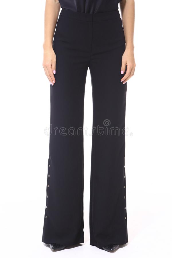 Flared black trousers on model legs with high heels stiletto shoes royalty free stock photos