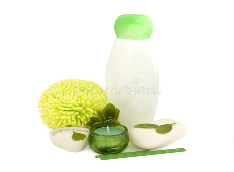 Flasche des Shampoos und der Kerze lizenzfreies stockfoto