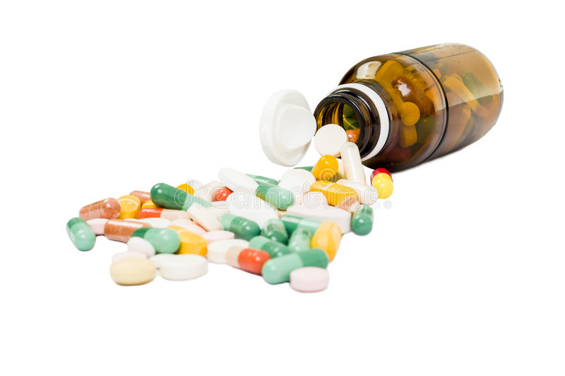 Flasche und verschüttete Pillen stockfoto
