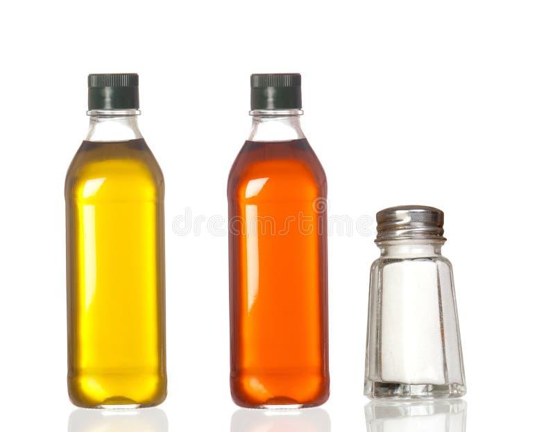 Flaschen des Schmieröl-, Essig- und Salzbootes stockbilder