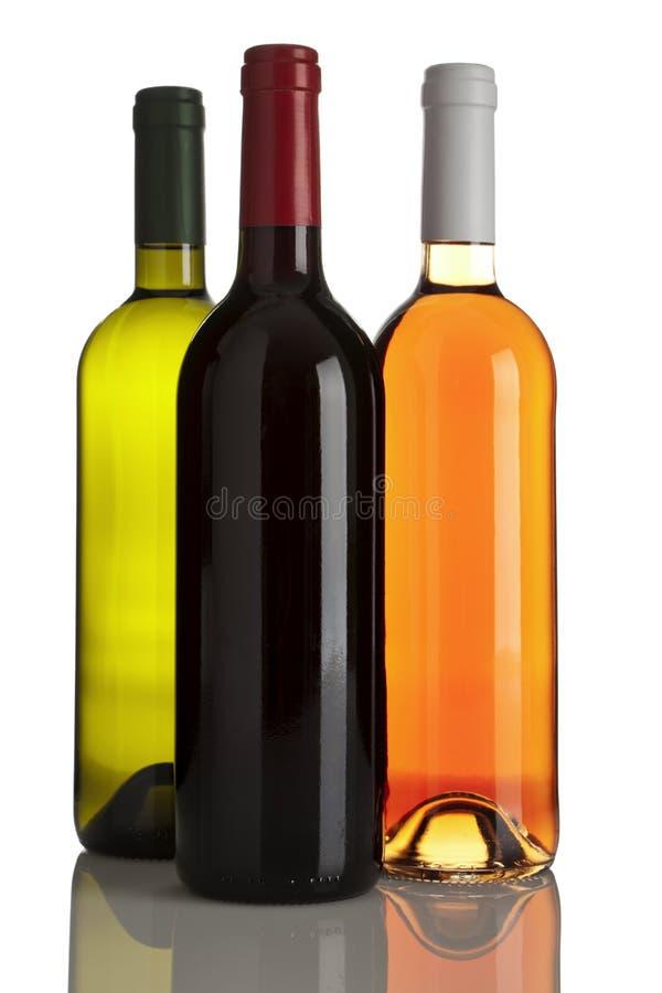 Flaschen des weißen, roten und rosafarbenen Weins trennten lizenzfreies stockbild