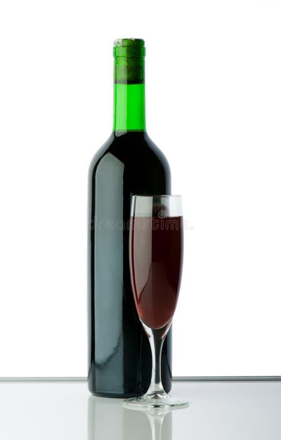 Flaschen- und Weinglas lizenzfreies stockbild