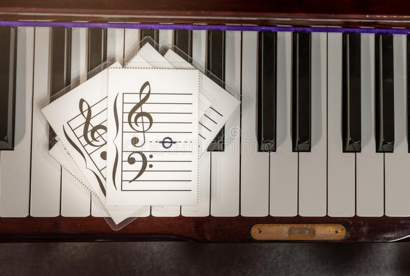 Flash cards with music note icon. Music flash cards on keys piano stock image
