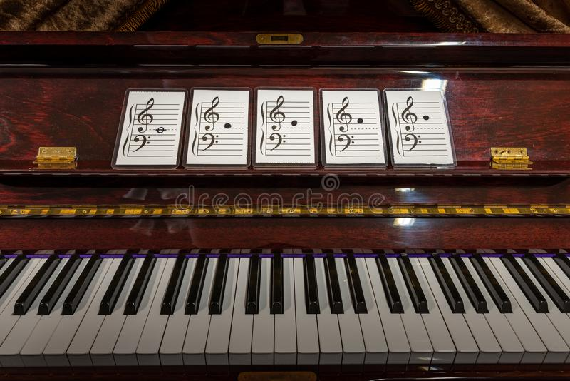 Flash cards of music note. On old piano. Concept of learning stock image