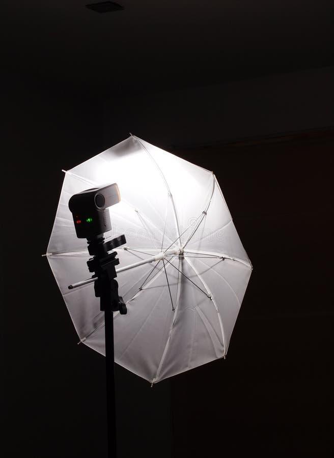 Flash light speed light on stand with white umbrella stock image