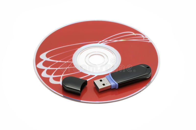 Flash memory and computer disk. Isolated on a white background royalty free stock photo
