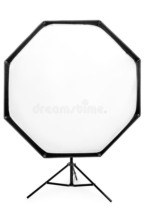 Flash with octagonal softbox on the rack, studio equipment close-up on a white. Background stock photo