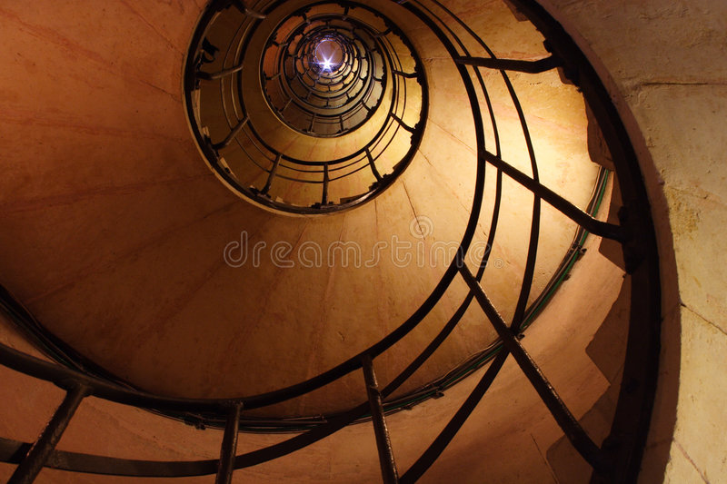 A flash at the top of the spiral stair royalty free stock photo