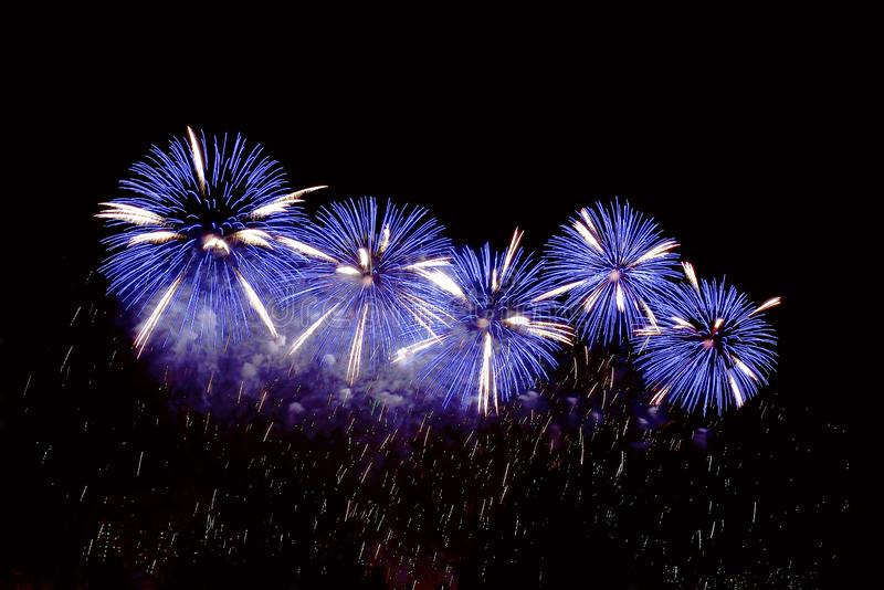 Flashes of blue fireworks and white sparks stock photography