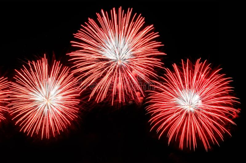 Flashes of fireworks of red color on a black background stock images