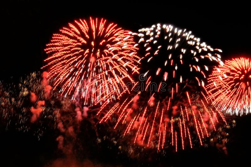 Flashes of fireworks of red and white color stock photo