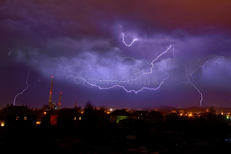 The Flashes on the night sky. Very bright flashes lit the night sky over the city stock images