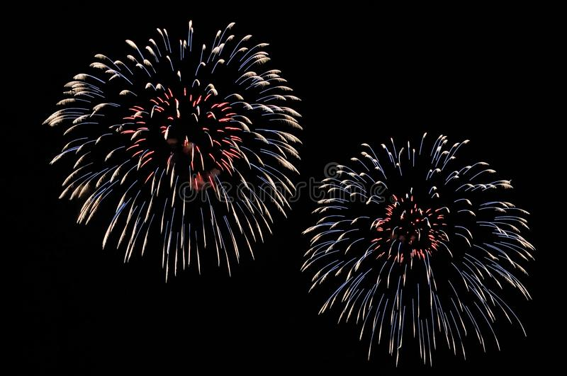 Flashes of red, blue and white fireworks stock image
