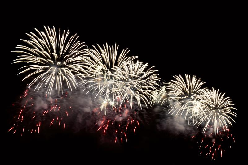 Flashes of white fireworks and red sparks royalty free stock images