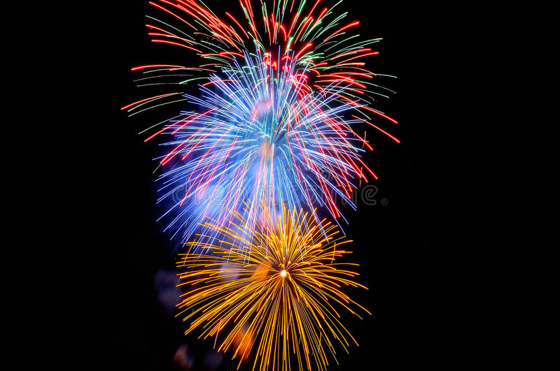Flashes of yellow blue red and green fireworks royalty free stock images