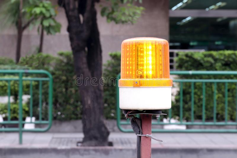 Flashing beacon lights for road works safety, warning lights for construction, indicator light of construction zone on the road. The flashing beacon lights for stock photos