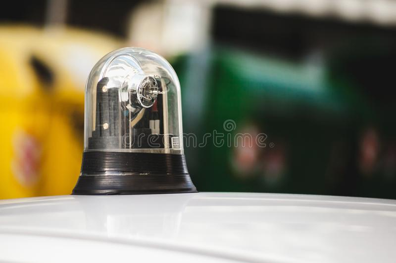 Flashing light on the roof of a police car. Close-up photo with selective focus royalty free stock photography