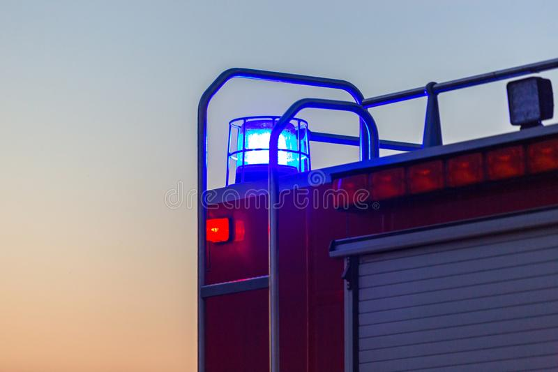 Flashing lights of red fire truck. At dusk stock images
