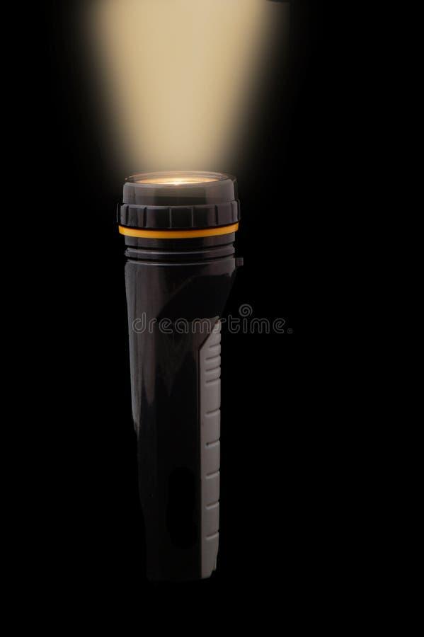 Flashlight. With beam against black background royalty free stock image