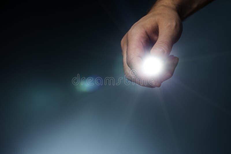 Flashlight. Man pointing a led flashlight towards camera stock photo