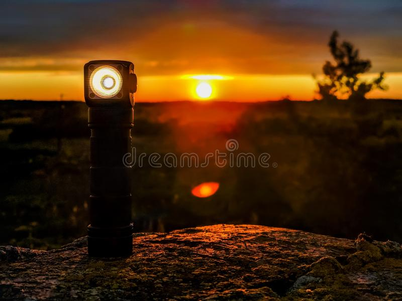 Flashlight light on the roof during sunset royalty free stock photography