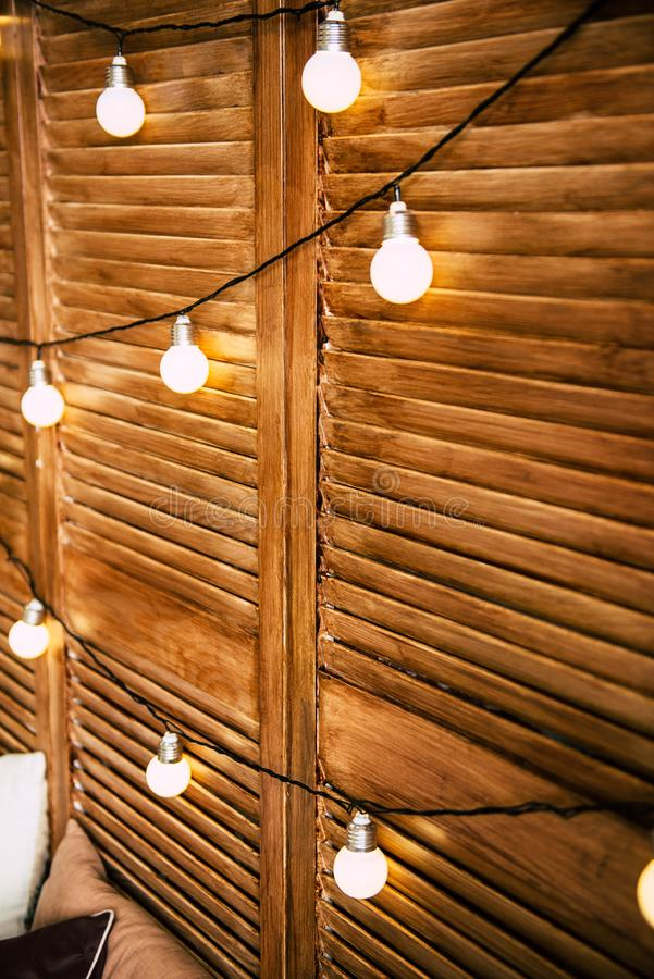 Lanterns on a wooden wall stock photo