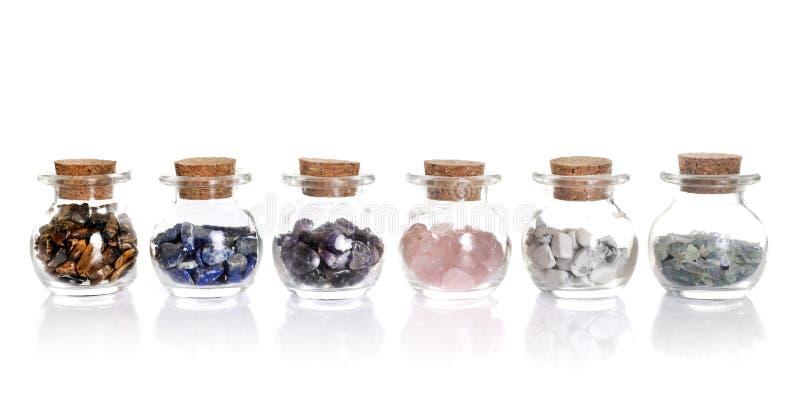 Flask with gems imagem de stock