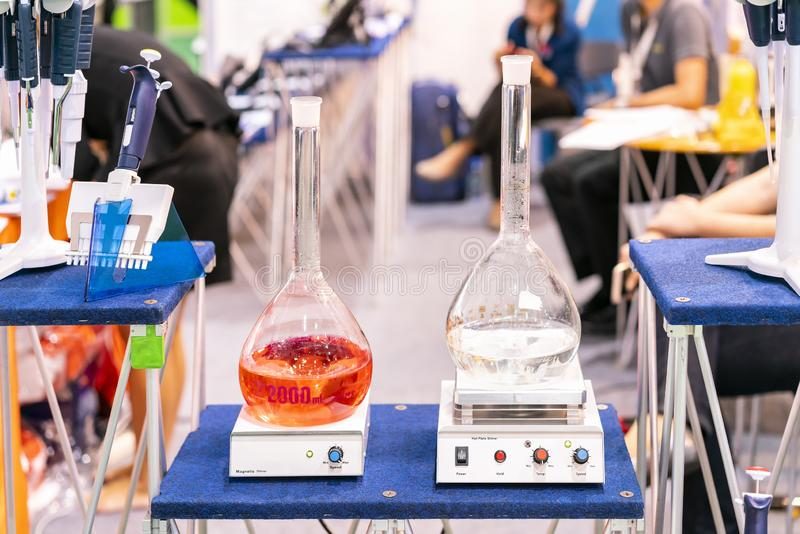Flask or vials circular for solution liquid on automatic stir or magnetic stirrer vortex mixer & hot plate device of lab. Application to industrial chemical stock photography