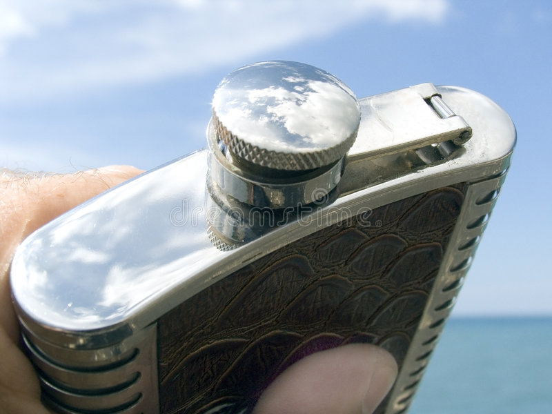 Flask with a wine. In a cover reflection of the sky stock photos