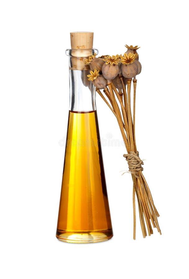 Flaska av Poppy Seed Oil och den torkade vallmo arkivfoto