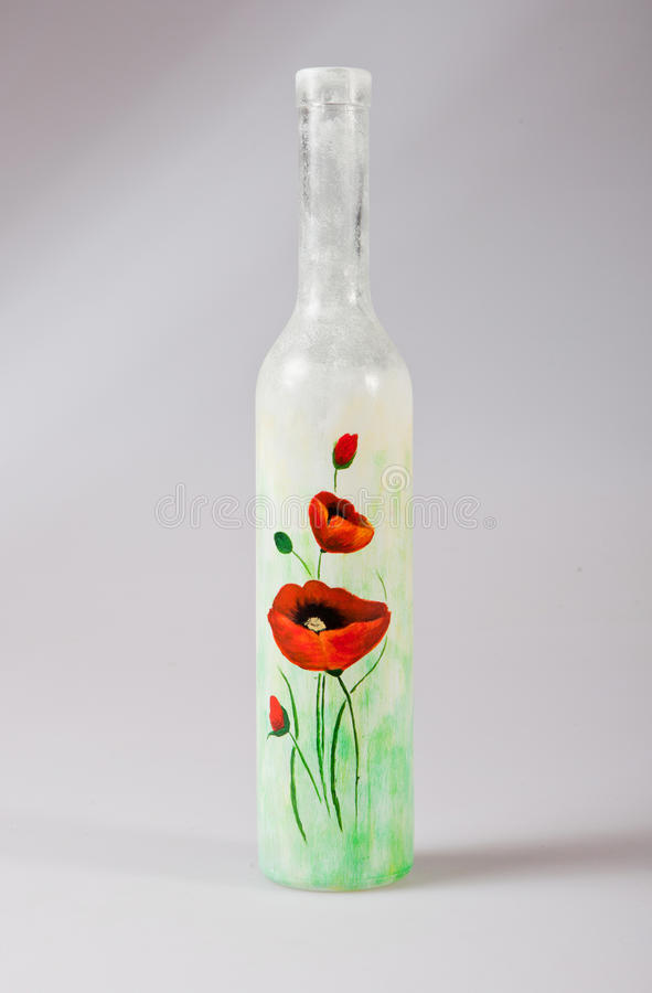 Flaska med macframdelen royaltyfria bilder