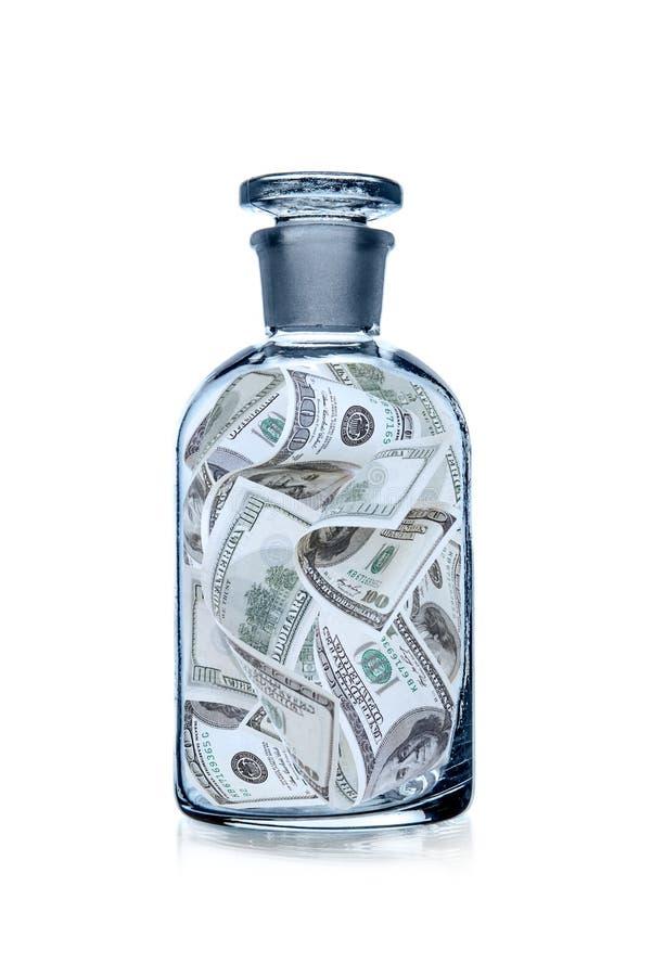 Flaska med USA dollar royaltyfri foto