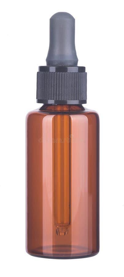 Flaska. skönhetsmedel buteljerar på bakgrunden arkivbild