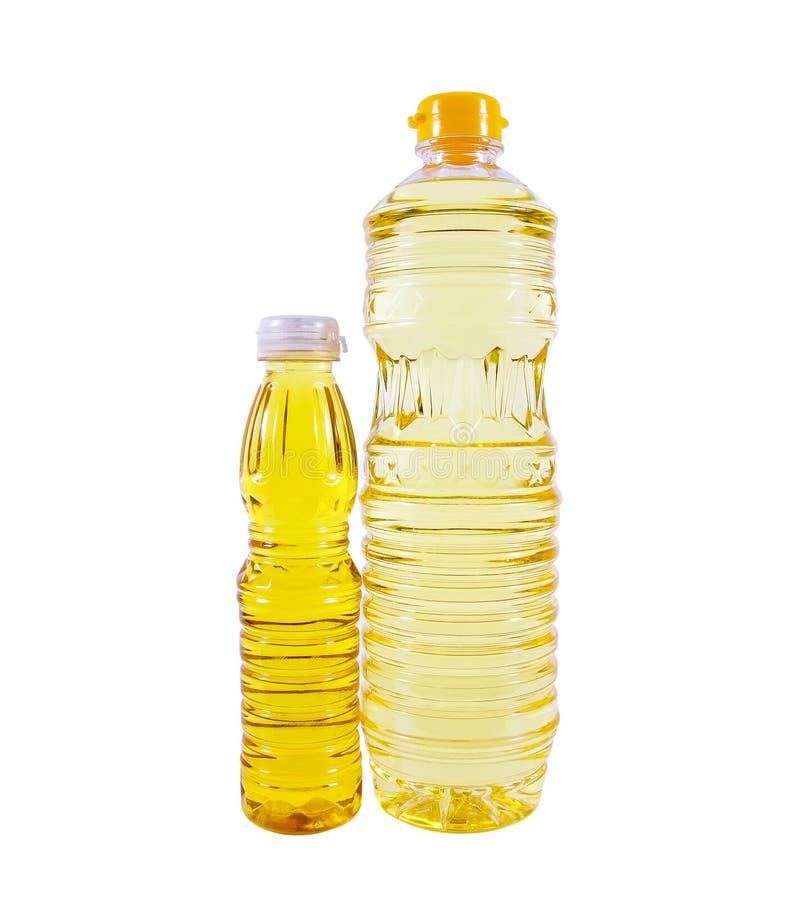 Flaska två av grönsakolja för att laga mat som isoleras på vit bakgrund royaltyfri bild