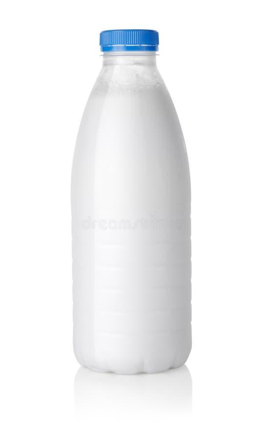 flaskan mjölkar banaplast- arkivfoto