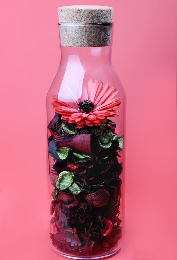 Flaskan och blomman within arkivfoton