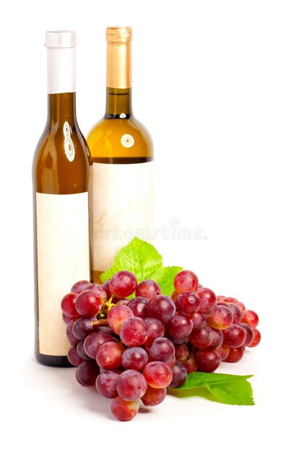 flaskdruvarött vin royaltyfri foto