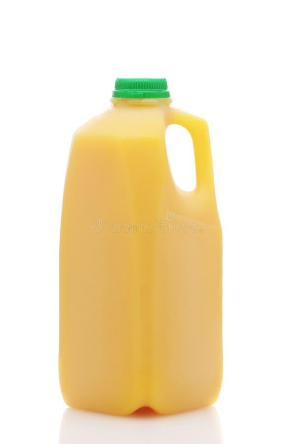 flaskfruktsaftorange royaltyfri bild