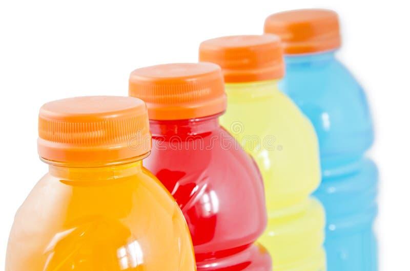 Flaskor av fruktsaft arkivfoton